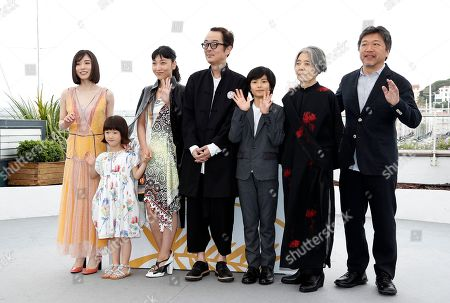 (R-L) Japanese director Hirokazu Kore-eda, Kirin Kiki, Jyo Kairi, Lily Franky, Miyu Sasaki, Sakura Ando and Mayu Matsuoka pose during the photocall for 'Shoplifters (Manbiki Kazoku)' at the 71st annual Cannes Film Festival, in Cannes, France, 14 May 2018. The movie is presented in the Official Competition of the festival which runs from 08 to 19 May.