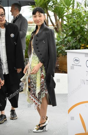Actress Sakura Ando poses for photographers during a photo call for the film 'Shoplifters' at the 71st international film festival, Cannes, southern France
