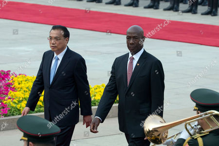 Li Keqiang, Keith Rowley. Trinidad and Tobago Prime Minister Keith Rowley walks with Chinese Prime Minister Li Keqiang during a welcome ceremony at the Great Hall of the People in Beijing, China