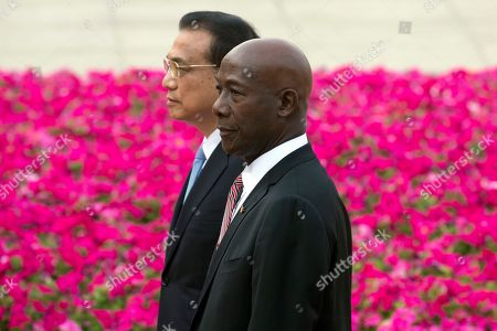 Keith Rowley, Li Keqiang. Trinidad and Tobago Prime Minister Keith Rowley walks with Chinese Prime Minister Li Keqiang during a welcome ceremony at the Great Hall of the People in Beijing, China