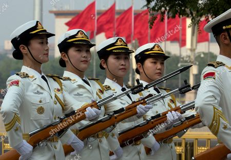 Female members of a Chinese honor guard rehearse outside the Great Hall of the People before a welcome ceremony for Trinidad and Tobago Prime Minister Keith Rowley in Beijing, China