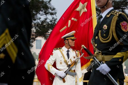 Members of a Chinese honor guard march prepare before a welcome ceremony for Trinidad and Tobago Prime Minister Keith Rowley outside the Great Hall of the People in Beijing, China