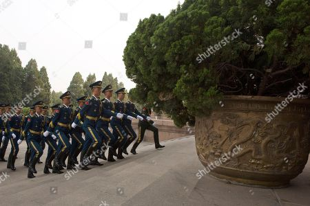 Members of a Chinese honor guard march on the steps of the Great Hall of the People before a welcome ceremony for Trinidad and Tobago Prime Minister Keith Rowley in Beijing, China