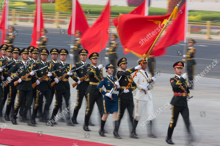 Members of a Chinese honor guard march outside the Great Hall of the People before a welcome ceremony for Trinidad and Tobago Prime Minister Keith Rowley in Beijing, China