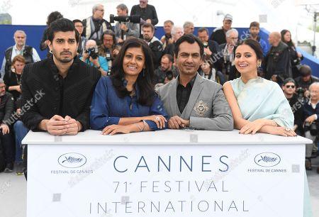 Tahir Raj Bhasin, Nandita Das, Nawazuddin Siddiqui, Rasika Dugal. Actor Tahir Raj Bhasin, from left, director Nandita Das, actor Nawazuddin Siddiqui and Rasika Dugal pose for photographers during a photo call for the film 'Manto' at the 71st international film festival, Cannes, southern France