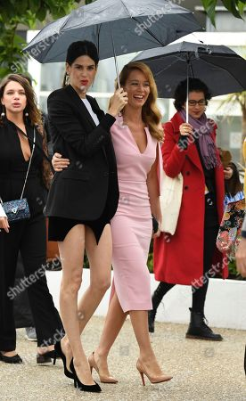 Luiza Mariani, Mariana Ximenes. Actresses Luiza Mariani, left, and Mariana Ximenes pose for photographers during a photo call for the film 'Le Grand cirque mystique' at the 71st international film festival, Cannes, southern France