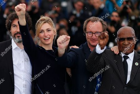 (L-R) William Jehannin producer Julie Gayet, composer Aurelien Chouzenoux, Andrew Mlangeni, pose during the photocall for 'The State Against Mandela' at the 71st annual Cannes Film Festival, in Cannes, France, 14 May 2018. The movie is presented in the section Special Screenings of the festival which runs from 08 to 19 May.