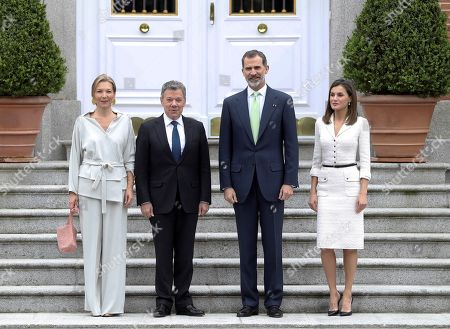 Spain's King Felipe VI (2-R) and Queen Letizia (R), welcome Colombian President, Juan Manuel Santos (2-L), and his wife Maria Clemencia Rodriguez, prior to a luncheon offered at La Zarzuela palace in Madrid, Spain, 14 May 2018. Santos is on a two-days official visit to Spain.