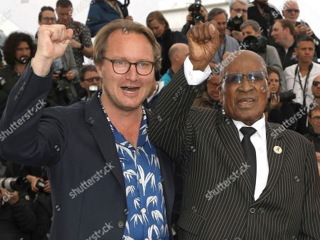 Nicolas Champeaux, Andrew Mlangeni. Director Nicolas Champeaux, left, and political activist Andrew Mlangeni pose for photographers during a photo call for the film 'The State Against Mandela and the Others' at the 71st international film festival, Cannes, southern France