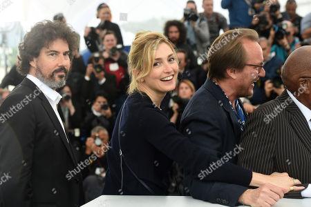 (L-R) William Jehannin producer Julie Gayet, composer Aurelien Chouzenoux and Andrew Mlangeni raise their fists