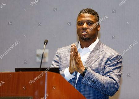 "Former NFL player Warrick Dunn speaks at the ""Beyond the Physical: A Symposium on Mental Health in Sports"" hosted by the NFL, NFL Players Association and Cigna at Georgia Tech Hotel and Conference Center, in Atlanta"