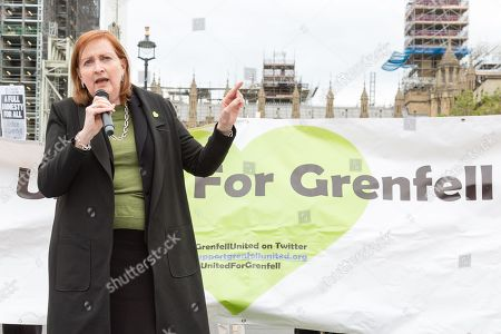 Stock Image of Emma Dent Coad speaks during a demonstration for the victims of the Grenfell Tower fire, opposite the Houses of Parliament in central London