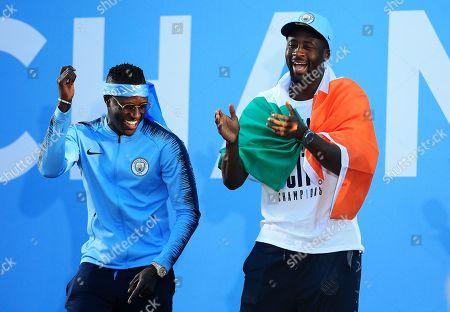 Benjamin Mendy and Yaya Toure of Manchester City