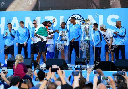 Yaya Toure of Manchester City walks on stage with teammates