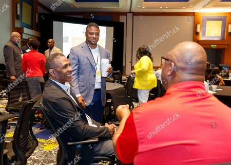 """Former NFL player Warrick Dunn speaks to attendees prior to the start of the """"Beyond the Physical: A Symposium on Mental Health in Sports"""" hosted by the NFL, NFL Players Association and Cigna at Georgia Tech Hotel and Conference Center, in Atlanta"""