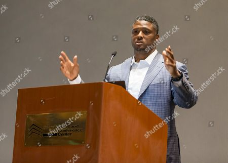 """Former NFL player Warrick Dunn speaks at the """"Beyond the Physical: A Symposium on Mental Health in Sports"""" hosted by the NFL, NFL Players Association and Cigna at Georgia Tech Hotel and Conference Center, in Atlanta"""