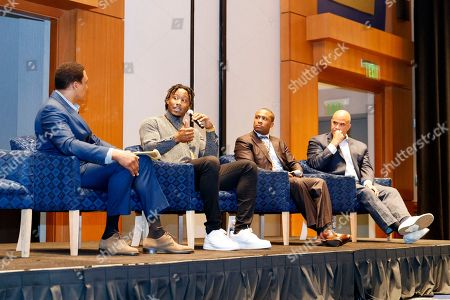 """A player panel consisting of from left to right, moderator Andre Collins, Brandon Marshall, Asher Allen and Aaron Taylor speaks at the """"Beyond the Physical: A Symposium on Mental Health in Sports"""" hosted by the NFL, NFL Players Association and Cigna at Georgia Tech Hotel and Conference Center, in Atlanta"""