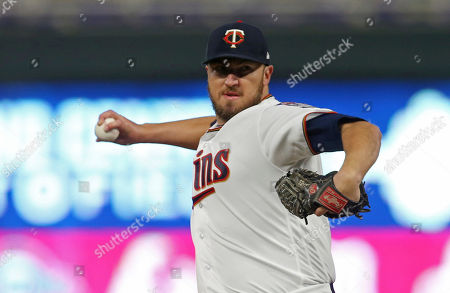 Minnesota Twins pitcher Phil Hughes throws against the Seattle Mariners a makeup baseball game, in Minneapolis