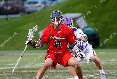 Albany, NY, U.S. - Ryan Lee (#11) works against the Albany defense as UAlbany Men's Lacrosse defeats Richmond 18-9 on  at Casey Stadium in the NCAA tournament first round