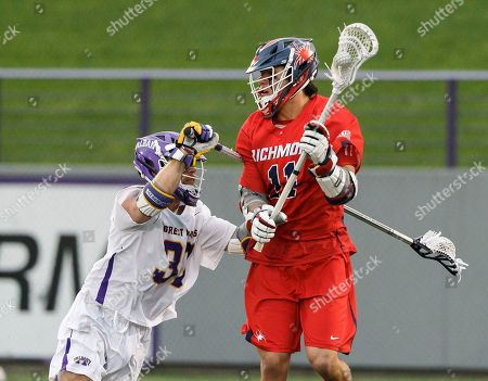 Albany, NY, U.S. - Albany's Erik Dluhy (#37) defends Richmond's Ryan Lee (#11) as UAlbany Men's Lacrosse defeats Richmond 18-9 on  at Casey Stadium in the NCAA tournament first round