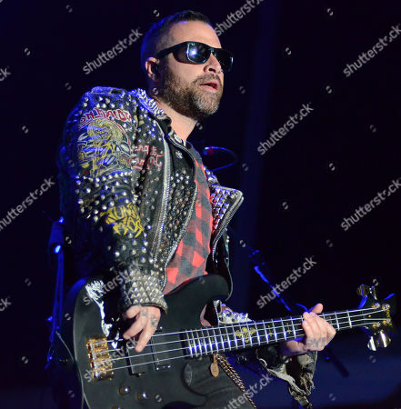 Bassist Johnny Christ of the band Avenged Sevenfold performs during the Northern Invasion Music Festival in Somerset, Wisconsin