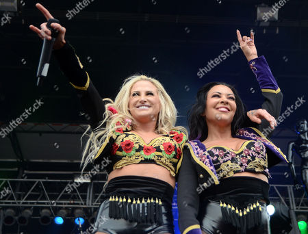 Vocalists Heidi Shepherd and Carla Harvey of the band Butcher Babies performs during the Northern Invasion Music Festival in Somerset, Wisconsin