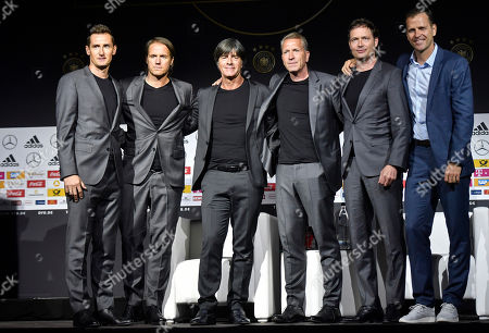 Germany's coaching team stands on a podium at the German Football Museum in Dortmund, Germany, Tuesday, May, 15, 2018 during the presentation of Germany's team for the Soccer World Cup in Russia. From left: Miroslav Klose, Hansi Flick, Joachim Loew, Andreas Koepke, Markus Sorg and Oliver Bierhoff