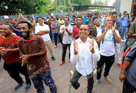 Supporters of  the Parliamentary Majority Alliance (AMP) applaud during a meeting with their leaders Xanana Gusmao and Taur Matan Ruak in Dili, East Timor, also known as Timor Leste, 15 May 2018. According to media reports, The Parliamentary Majority Alliance (AMP) with three political parties led by the CNRT secured a majority on the parliamentary election.