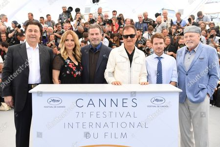 Leo Rossi, Kelly Preston, John Travolta, Edwaurd Walson, Kevin Connolly, Stacy Keach. Actors Leo Rossi, from left, Kelly Preston, John Travolta, producer Edwaurd Walson, director Kevin Connolly, and actor Stacy Keach pose for photographers during a photo call for the film 'Gotti' at the 71st international film festival, Cannes, southern France