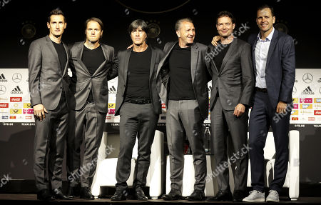 German national soccer team head coach Joachim Loew (3-L) poses for photographers with German national soccer team officials (L-R) Miroslav Klose, Thomas Schneider, Andreas Koepke, Marcus Sorg, and Oliver Bierhoff during a press conference to announce the provisional German squad for the FIFA World Cup 2018 at the German soccer museum in Dortmund, Germany, 15 May 2018. The FIFA World Cup 2018 will take place in Russia from 14 June until 15 July 2018.
