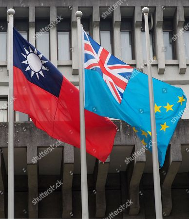 The national flags of Taiwan (L) and Tuvalu (R) fly side by side outside Taiwan's Foreign Ministry in Taipei, Taiwan, 15 May 2018, as Tuvalu's Prime Minister Enele Sosene Sopoaga is visiting Taipei. Taiwan is recognized by 19 mostly-small countries and is fighting an uphill battle to preserve ties as China sees Taiwan as its breakaway province and urges Taiwan's allies to drop Taiipei and recognize Beijing.