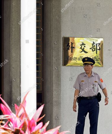 A security guard stands guard at an entrance of the Foreign Ministry in Taipei, Taiwan, 15 May 2018, as Tuvalu's Prime Minister Enele Sosene Sopoaga is visiting Taipei. Taiwan is recognized by 19 mostly-small countries and is fighting an uphill battle to preserve ties as China sees Taiwan as its breakaway province and urges Taiwan's allies to drop Taiipei and recognize Beijing.