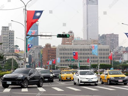 National flags of Taiwan (Red) and Tuvalu (Blue) fly in the streets of Taipei, Taiwan, 15 May 2018, as Tuvalu's Prime Minister Enele Sosene Sopoaga is visiting Taipei. Taiwan is recognized by 19 mostly-small countries and is fighting an uphill battle to preserve ties as China sees Taiwan as its breakaway province and urges Taiwan's allies to drop Taiipei and recognize Beijing.