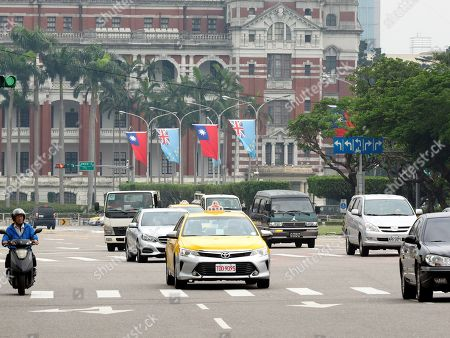 National flags of Taiwan (Red) and Tuvalu (Blue) fly outside the Presidential Office building in Taipei, Taiwan, 15 May 2018, as Tuvalu's Prime Minister Enele Sosene Sopoaga is visiting Taipei. Taiwan is recognized by 19 mostly-small countries and is fighting an uphill battle to preserve ties as China sees Taiwan as its breakaway province and urges Taiwan's allies to drop Taiipei and recognize Beijing.