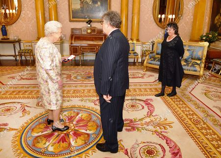 Queen Elizabeth II with Paul Muldoon and Poet Laureate Carol Ann Duffy (right), before she presented him with the Queen's Gold Medal for poetry, during a private audience at Buckingham Palace