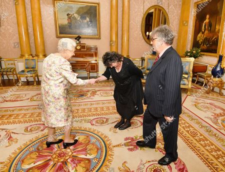 Queen Elizabeth II with Paul Muldoon and Poet Laureate Carol Ann Duffy (centre), before she presented him with the Queen's Gold Medal for poetry, during a private audience at Buckingham Palace