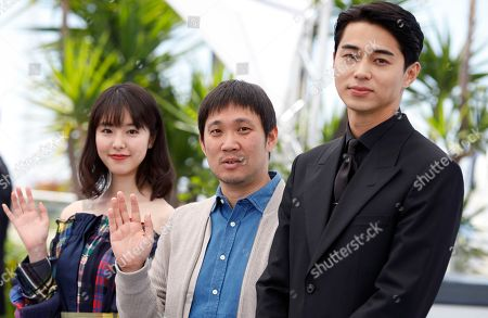 (L-R) Japanse actress Erika Karata, Director Ryusuke Hamaguchi and Masahiro Higashide pose during the photocall for 'Asako I & II (Netemo Sametemo)' at the 71st annual Cannes Film Festival, in Cannes, France, 15 May 2018. The movie is presented in the Official Competition of the festival which runs from 08 to 19 May.