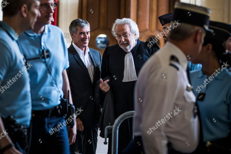 Former French Budget Minister Jerome Cahuzac (C-L) and his lawyer Jean-Alain Michel (C-R) leave the Appeal Court in Paris, France, 15 May 2018. Cahuzac was sentenced to a four year suspended prison sentence for tax fraud in 2016.