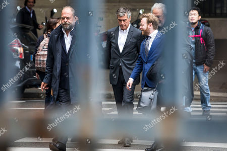 Stock Image of Former French Budget Minister Jerome Cahuzac (C) and his lawyer Eric Dupond-Moretti (L) nd associate lawyer Antoine Vey 'R) arrive at the Appeal Court in Paris, France, 15 May 2018. Cahuzac was sentenced to a four year suspended prison sentence for tax fraud in 2016.