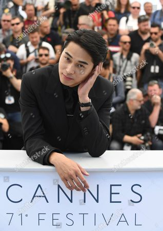 Actor Masahiro Higashide poses for photographers during a photo call for the film 'Asako I & II' at the 71st international film festival, Cannes, southern France