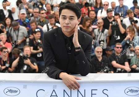 Stock Image of Actor Masahiro Higashide poses for photographers during a photo call for the film 'Asako I & II' at the 71st international film festival, Cannes, southern France