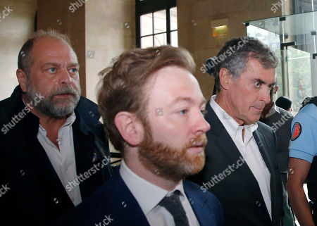 Former French budget Minister Jerome Cahuzac, right, arrives with his legal team at the Paris court house in Paris, France, . A former French budget minister, who was in charge of fighting tax evasion in the country, has been again convicted of tax evasion and money laundering but received a reduced sentence at his appeal trial