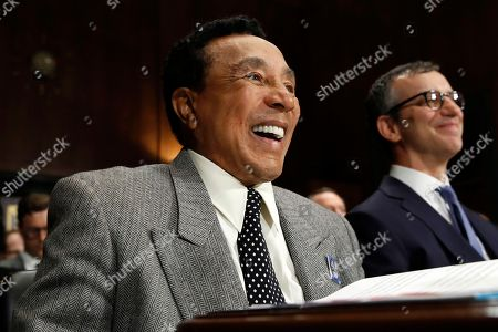 Stock Image of Smokey Robinson, David Israelite. Singer Smokey Robinson laughs during his introduction at a Senate Judiciary Committee hearing on music protections, on Capitol Hill in Washington. At right is National Music Publishers Association President and CEO David Israelite
