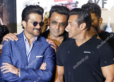 "Bollywood actors, from left, Anil Kapoor, Bobby Deol and Salman Khan attend the trailer launch of their film Race 3"" in Mumbai, India"