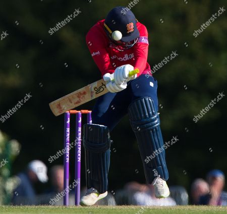 Tom Westley is struck on the helmet by bowler Tom Barber