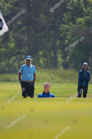 Teddy Sheringham looks up to check his shot from the bunker