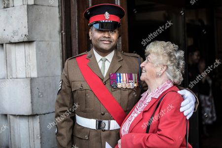 Victoria Cross recipient Johnson Beharry greets guest Cynthia Rolfe at the door of St Martin's in the field church for the bi-annual service of the Victoria Cross and George Cross Association.