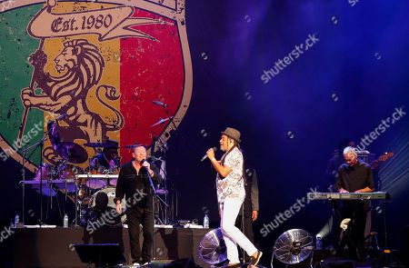 British band UB40's Mickey Virtue (R), Astro (C) and Ali Campbell (L) perform on stage at the Grand West Arena in Cape Town, South Africa, 15 May 2018. The performance is part of their 25th Anniversary Tour which has taken the band to North and South America, Nigeria, Dubai, Europe and Papua New Guinea.