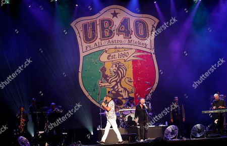 British band UB40's Mickey Virtue (R), Astro (C-L) and Ali Campbell (C-R) perform on stage at the Grand West Arena in Cape Town, South Africa, 15 May 2018. The performance is part of their 25th Anniversary Tour which has taken the band to North and South America, Nigeria, Dubai, Europe and Papua New Guinea.
