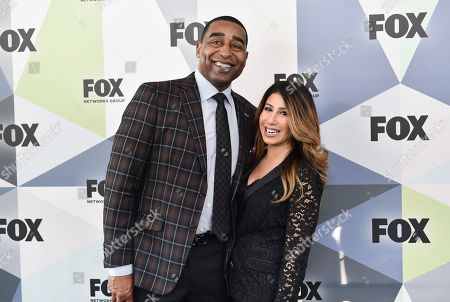 "Stock Image of First Things First"" co-host Cris Carter and girlfriend attend the Fox Networks Group 2018 programming presentation after party at Wollman Rink in Central Park, in New York"